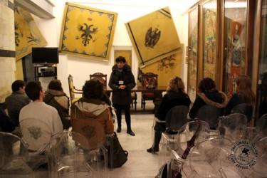Students visit the contrada museum of L'Aquila.